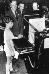Sir Warwick Fairfax shows his son Warwick jnr the Fairfax printing presses.