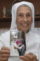 St Mary's School vice-principal Sister Ana Rosa Sivori shows a picture taken with Pope Francis - she shares a great-grandfather with Jorge Mario Bergoglio, who, six years ago, became Pope Francis.