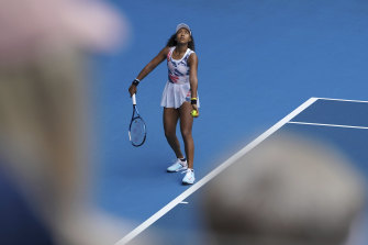 Naomi Osaka had a comfortable first-round win aver Marie Bouzkova.