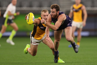 Connor Blakely gets a handball away for Fremantle.
