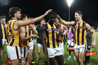 Hawthorn's Changkuoth Jiath celebrates victory in round 21.