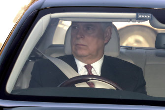 Prince Andrew drives himself to Buckingham Palace for the royal family's traditional pre-Christmas lunch.