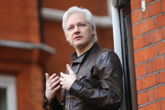 Julian Assange speaks to the media from the balcony of the Ecuador embassy in 2017.