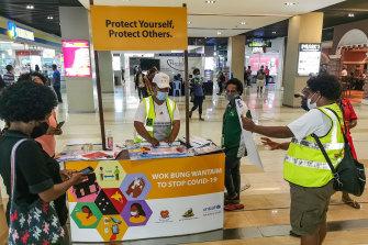 A stand distributes COVID-19 information at a shopping centre in Port Moresby.