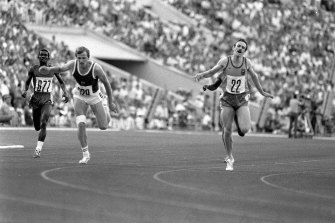 Rick Mitchell, right, pictured on 27 July, 1980 on his way to a silver medal in the 400m final.