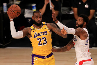 LA's LeBron James passes the ball in the NBA's comeback.
