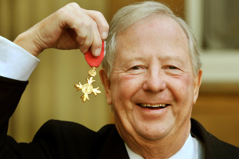 Tim Brooke-Taylor holds his OBE after it was presented to him by Prince Charles at Buckingham Palace in 2011.