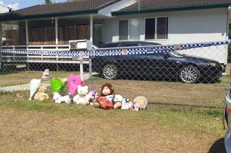 The Logan community left flowers and toys in honour of the two girls who died.