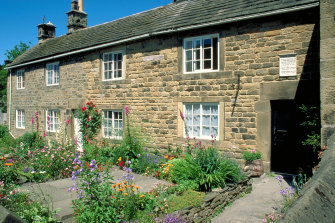 """The so-called """"Plague Cottage"""" of Eyam, in Derbyshire. The white plaque above the door on the right commemorates the village's first plague victims in 1665, including tailor's assistant George Vicars."""