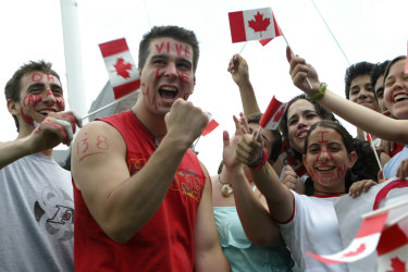 TORONTO - JULY 1:  People celebrate Canada's 138th birthday at Queen's Park on July 1, 2005 in Toronto, Canada. July 1st, known as Canada Day, celebrates the day the Canadian government was created.  (Photo by Donald Weber/Getty Images) Getty image for Traveller. Single use only. National days around the world Michael Gebicki column