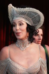Cher at the 1998 Academy Awards wearing a hat that would be right at home in Moore Park.