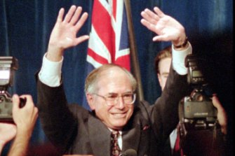 Liberal Party leader John Howard waves to the crowd after his victory in the 1996 election.