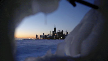 Ice forms along the shore of Lake Michigan in Chicago before sunrise on Thursday.