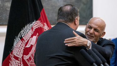 Afghan President Ashraf Ghani, right, and Secretary of State Mike Pompeo, left, hug following a news conference at the Presidential Palace in Kabul, Afghanistan, on July  9.