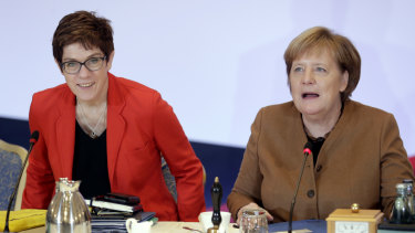 German Chancellor and CDU chairwoman Angela Merkel, right, and the party's Secretary General, Annegret Kramp-Karrenbauer attend a board meeting prior to the vote.