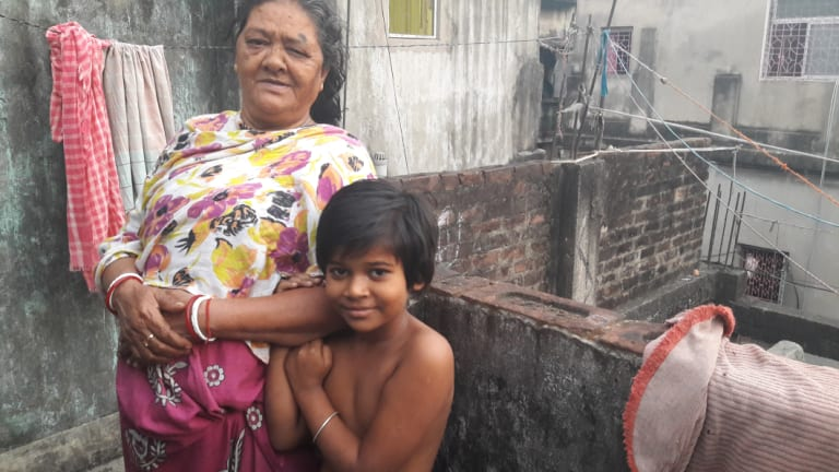 Brothel 'madam' Renu Singh and her granddaughter in the red light area of Sonagachi, Calcutta.