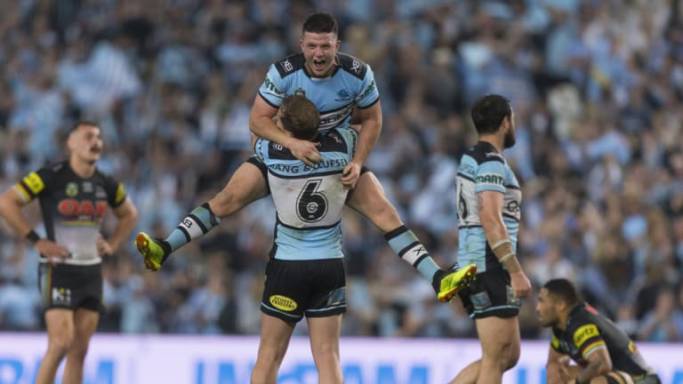 Up, up Cronulla: Chad Townsend jumps into the arms of Matt Moylan after the Sharks' victory.