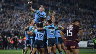 New South Wales celebrate their victory over Queensland.