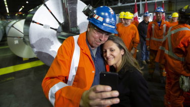 Jeremy Spence, an area manager in cold rolling at Stelco, takes a selfie with Chrystia Freeland, Canada's Minister of Foreign Affairs.