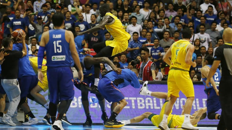 Boomers player Thon Maker tries to high kick a Philippines player.