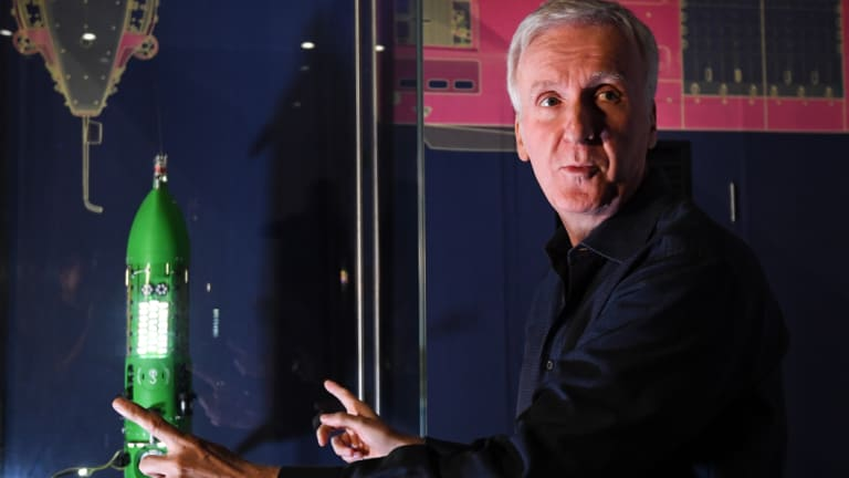 James Cameron poses for a photo with a scale model of the Deepsea Challenger at the Australian National Maritime Museum in Sydney on Monday.