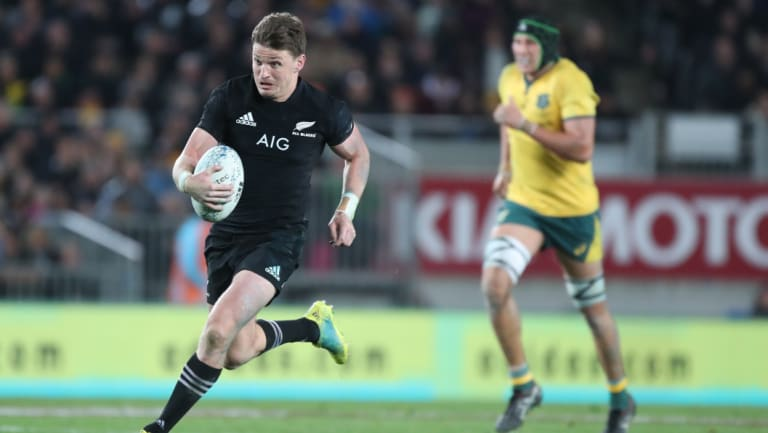 Rare feat: Beauden Barrett breaks up the middle to score one of his four tries against Australia.