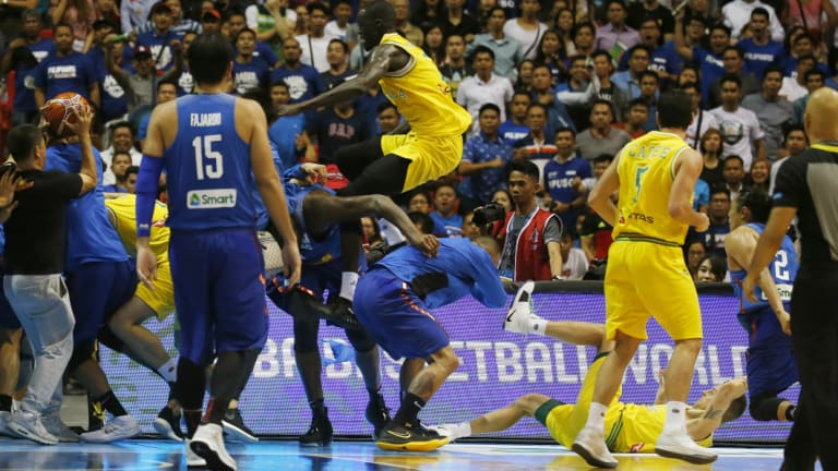 Boomers player Thon Maker flies at a Philippines player.