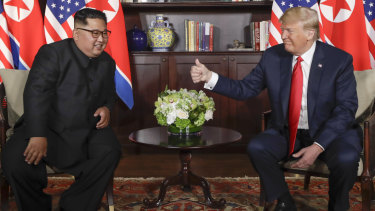 US President Donald Trump gives North Korean leader Kim Jong-un a thumbs up during their meeting at a resort on Sentosa Island in Singapore on Tuesday, June 12.
