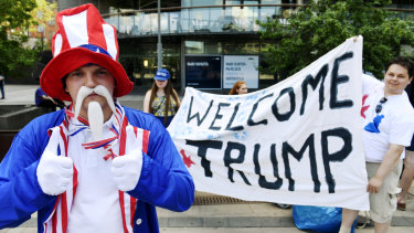 Teppo Marttila, dressed as Uncle Sam, participates in the demonstration by the True Finns youth members in support of Donald Trump in Helsinki on Sunday.