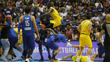 Ugly scenes: Boomers player Thon Maker flies at a Philippines player.