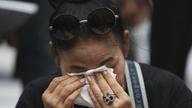 A supporter of the Thai Raksa Chart party cries at the Constitutional Court in Bangkok.