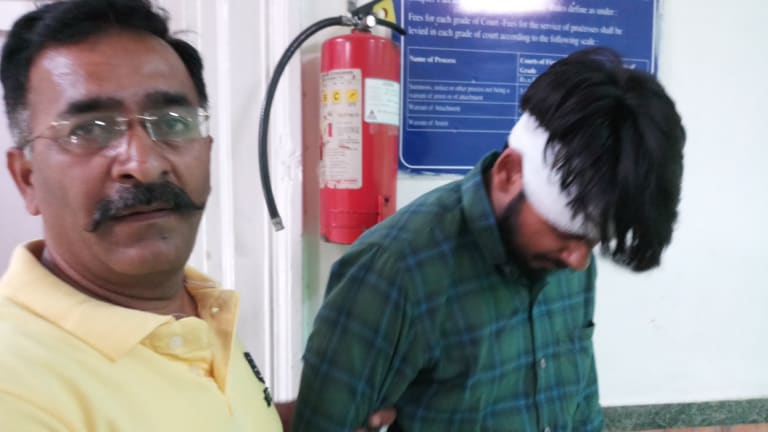 Hit-run driver Puneet Puneet (right) leaves court with his uncle in New Dehli in June.