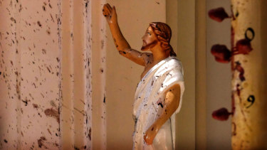 Blood stains are seen on the wall and on a Jesus Christ statue at the St Sebastian's Church after a blast in Negombo, north of Colombo, Sri Lanka.