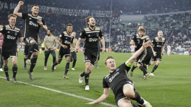 Ajax celebrate after their win.