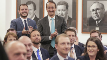 Phil Thompson and Dave Sharma are welcomed by Scott Morrison during a joint party room meeting.