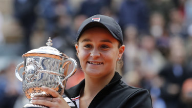Jubilant: Australia's Ashleigh Barty holds the trophy.