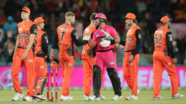 Sydney Sixers star Dan Christian shakes hands with Dan Christian of the Scorchers, who are wearing their Indigneous strip.