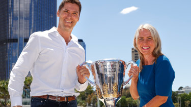 Simon Black and The Honourable Kate Jones MP (Queensland Minister for State Development, Tourism and Innovation) pose for a photograph during the 2020 AFL Grand Final Footy Festival.