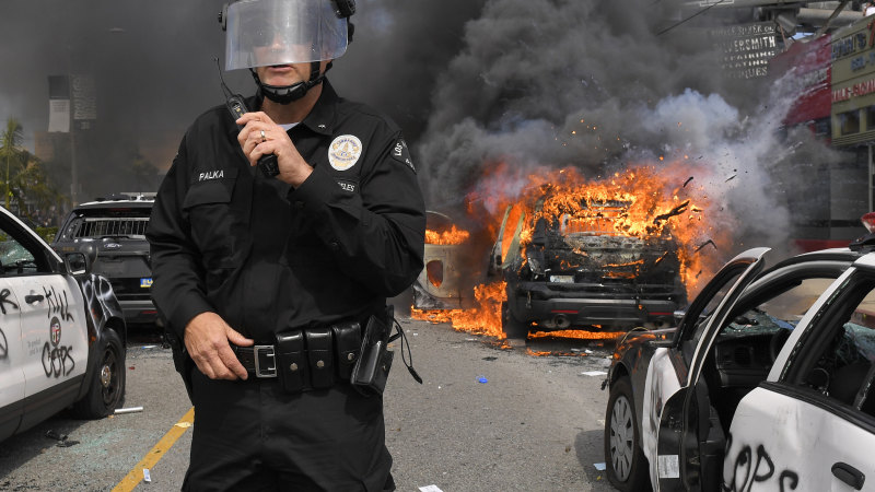 Clashes, looting and buildings torched: US protesters defy curfews in dozens of cities