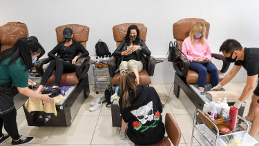 Monty Howe (left) and mates getting in early for a pedicure at Venus Nails Salon on Chapel Street.