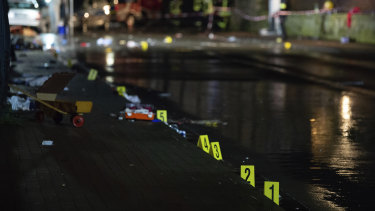 Investigators' markings are seen near the car that drove into a crowd of people during a carnival procession in Volkmarsen.