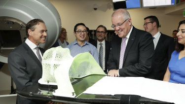 Prime Minister Scott Morrison and Health Minister Greg Hunt visit the Icon Cancer Centre in Canberra on Monday.
