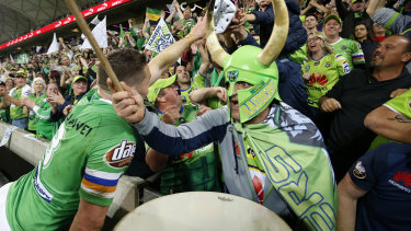 Raiders fans celebrate with Jarrod Croker in Melbourne.