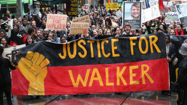 Protesters march in Melbourne over the death of Kumanjayi Walker.