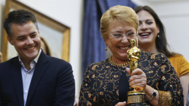 "Then Chile's president Michelle Bachelet holds the Oscar statuette during a meeting with Sebastian Lelio, left, and Daniela Vega, right, director and actress of the Oscar winning foreign language film ""A Fantastic Woman"" days before the end of her term in March."
