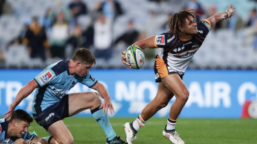 Issak Fines celebrates a try for the Brumbies.