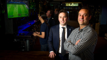 MLA Michael Pettersson wants to capture a corner of the booming Asian tourism market in video gaming as a spectator sport. Pictured with Reload co-owner Ravi Sharma.
