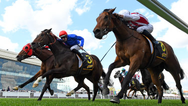 Hugh Bowman rides Flit to a three-way photo finish win at the Thousand Guineas.