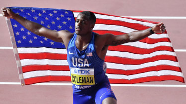 Christian Coleman celebrates his 100m victory at last year's World Athletics Championships in Doha.