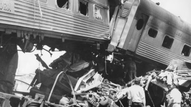 Two lesser damaged carriages of the Aurora straddle the ruin of a third carriage and part of the goods train.